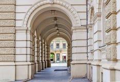 A long corridor between many columns Royalty Free Stock Image
