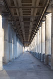 A long corridor between many columns in a historical building in berlin Royalty Free Stock Images