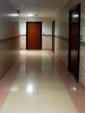 Long Corridor With Metal Doors, Tilled Wall And Floor Stock Photo