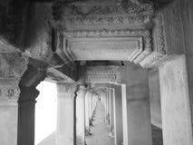Long corridor of pillars inside the Angkor wat Stock Photography