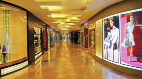 Long corridor and shops inside shopping mall Royalty Free Stock Photo