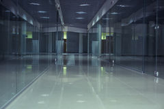 Long corridor and showcase. A long corridor and the empty shop windows Stock Images