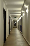The long corridor with a succession of wall lamps, in its own electrical lighting Stock Images