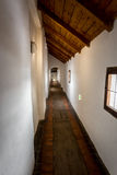 Long corridor with wooden floor at old castle. Ancient long corridor with wooden floor at old castle royalty free stock images