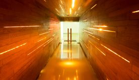 Long Corridor with Wooden and Light Line in Orange Tone Stock Images
