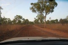 Long corrugated, red dirt road in Kimberley region in Western Australia stock image
