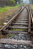 Long crossing railways during the cloudy day. Iron railways crossroad in the nature during day stock images