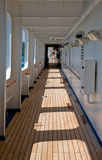 Long Cruise ship deck corridor. Interior architectural details of long wooden corridor deck on cruise ship royalty free stock image