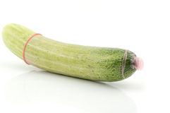 Long cucumber with condom Royalty Free Stock Photography