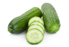 Long cucumber on white Stock Images