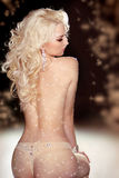 Long curly Hair. Back of slim blond woman wearing in twinkled li Royalty Free Stock Photography