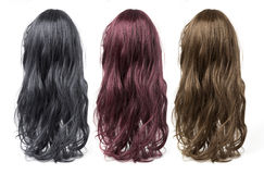 Long curly  wigs. Set of long curly  wigs on a white background Stock Photography