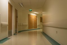 Curved hospital corridor at night royalty free stock photography