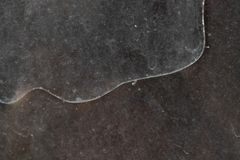 Long curved crack on dirty and dusty glass in an abandoned building stock photography