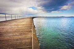 Long Curving Jetty Stock Image