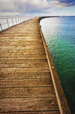 Long Curving Jetty Stock Images