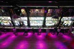 Long dance floor near bar with people stock image