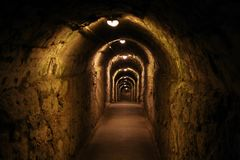 Long dark corridor with lighting lamps.  Royalty Free Stock Images