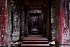Dark corridor passage in the Angkor temple royalty free stock photo