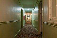 Long Dark and Creepy Hallway in an Old American Apartment Building royalty free stock photography