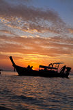 Longtail boat at sunset Stock Image