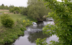 Long Daylight Exposure Of Stolen Car Dumped In The River Dearne. Wath Upon Dearne, Rotherham, South Yorkshire, England Stock Photography