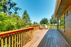Long Deck, terrace with wood railings and green landscape. Royalty Free Stock Photos