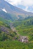 Long deep waterfall and glaciers. Royalty Free Stock Photos