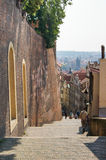 Long descent. Prague, Czech Republic - 12, June, 2015.People at the end of a long descent along the high walls Royalty Free Stock Photo
