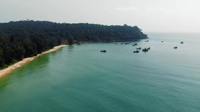 Long deserted beach with white sand and clear water. Aerial top view. Coast of island Koh Rong Samloem, Cambodia stock video footage