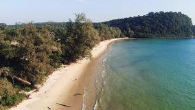 Long deserted beach with white sand and clear water. Aerial top view. Coast of island Koh Rong Samloem, Cambodia stock footage