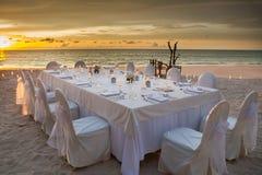 Long dinner table Stock Photos