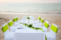 Long dinner table. Setup for wedding ceremony on beach Stock Photo