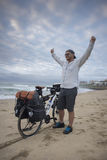 Long Distance Cyclist on Beach with Arms in the Air Stock Photos