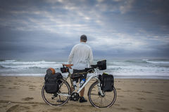 Long Distance Cyclist on beach with Bicycle Royalty Free Stock Image