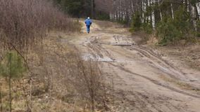 The long distance runner. On forest road stock footage