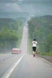 Long Distance Runner. A long distance runner on a remote desert highway Stock Image