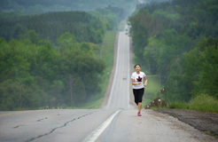 Long Distance Runner. A long distance runner on a remote desert highway Stock Photography