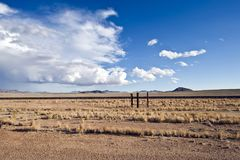 Vastness in desert of South Namibia. Long distance to the mountains in the backin the desert near Luederitz, Namibia Stock Images
