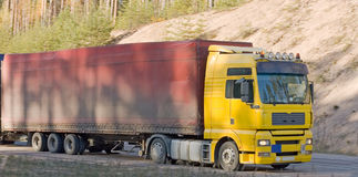 Long distance trailer truck. Long distance trailer or semi truck for commercial transportation Stock Photos