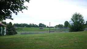 A long distance view of a tee ball or little league baseball game. 7-9-2018 stock video