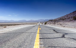 Long Distant Highway Under the Summer Sun Across Death Valley Na Royalty Free Stock Photos