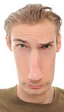 Long Distorted Face. A young man with a really long distorted face isolated on white background stock photo