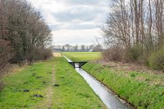 Long ditch with a small weir Stock Photo