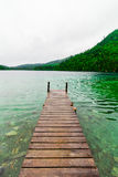 Long Dock and Amazing View of a Lake Stock Photo