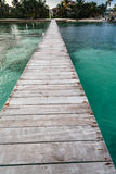 Long dock at resort in tropical waters of Caribbean Sea Stock Photo