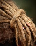 Long dreadlocks. With various ornaments Royalty Free Stock Photo