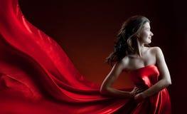Long dress. Beautiful young woman in red long dress Royalty Free Stock Photo