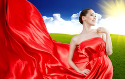 Long dress. Beautiful young woman in red long dress Stock Photos