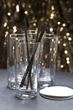 Long drink glasses with straws and coaster Stock Photo
